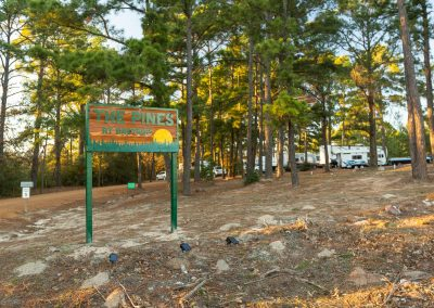 the pines at bastrop rv park sign